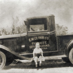 1930's<br />Gene Cloud, Jr. sitting on his father's first pest control truck