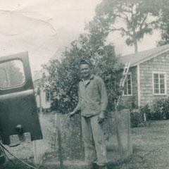 1950's<br /> Gene Cloud, Jr. performing a termite treatment on a local home